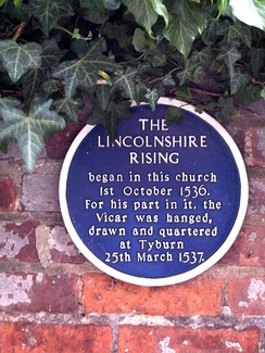 Plaque commemorating the Lincolnshire Rising, opposite south entrance to St James' Church, Louth