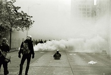 "Protester facing riot police in the ""Battle of Seattle"""
