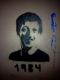 Graffiti in Berlin of Facebook founder Mark Zuckerberg. The caption is a reference to George Orwell's novel Nineteen Eighty-Four.