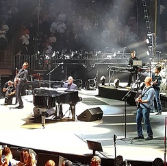 Billy Joel with his band performing in California
