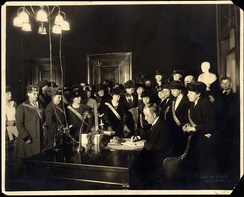 Governor Edwin P. Morrow signs ratification bill for Kentucky, January 6, 1920, with members of the Kentucky Equal Rights Association watching.
