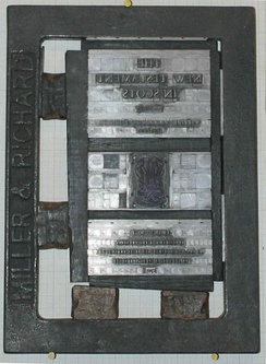 "A single-page ""forme"" for printing the front page of the New Testament of the Christian Bible. The black frame surrounding it is the ""'chase""', and the two objects each on the bottom and left side are the ""quoins""."