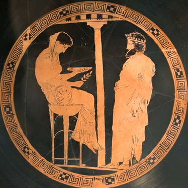 "Aegeus at right consults the Pythia or oracle of Delphi. Vase 440–430 BC. He was told ""Do not loosen the bulging mouth of the wineskin until you have reached the height of Athens, lest you die of grief"", which at first he did not understand."