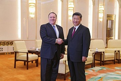 Secretary of State Mike Pompeo shakes hands with Chinese Communist Party general secretary Xi Jinping upon arrival in Beijing, 14 June 2018.