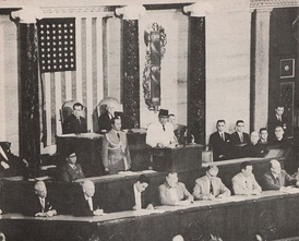 Indonesian President Sukarno addresses Congress in 1956. Sitting behind him Vice President Nixon and Speaker Rayburn.