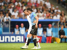 Cavani being helped off the field by Cristiano Ronaldo after Uruguay's win over Portugal at the 2018 World Cup