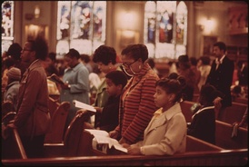 Worshippers at Holy Angel Catholic Church on the South Side of Chicago, Illinois, by John H. White, 1973.