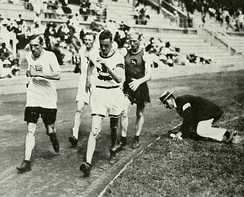A track-side judge monitoring technique at the 1912 Summer Olympics in Stockholm, Sweden.