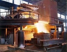 Molten steel being poured from an electric arc furnace.