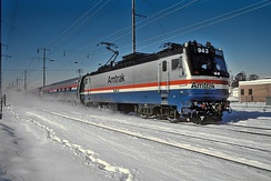 An EMD AEM-7 with a Metroliner in 1987. The AEM-7 was Amtrak's workhorse on electrified routes for over 30 years.