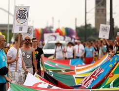 LGBT activists at Cologne Pride carrying a banner with the flags of over 70 countries where homosexuality is illegal.
