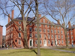 Hollis Hall: a four-story red brick building with white trim in a courtyard.