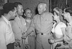Writer Hal Block (far left) and Hope (second from left) meet George Patton in Sicily during World War II