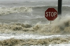 Waves crash against a stop sign in Bay St. Louis, Mississippi, as Hurricane Gustav hits the Gulf Coast.