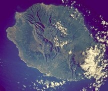 Réunion from space (NASA image): The three cirques, forming a kind of three-leafed clover shape, are visible in the central north west of the image. Piton de la Fournaise, in the south east, is covered by cloud.