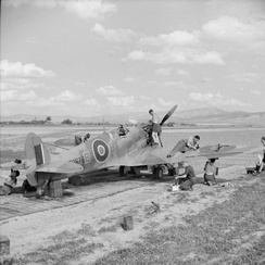 Ground crew servicing a Supermarine Spitfire of No. 154 Squadron in its dispersal at Souk el Khemis ('Victoria'), Tunisia.