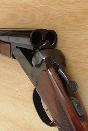 A view of the break-action of a typical double-barrelled shotgun, shown with the action open
