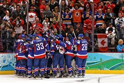 The Slovak national ice hockey team celebrating a victory against Sweden at the 2010 Winter Olympics