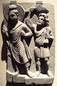 The Buddha with his protector Vajrapāni. Gandhara, 2nd century