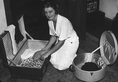Thelma Coyne packing for her overseas tour in 1938 as a member of the Australian Women's Tennis Team.