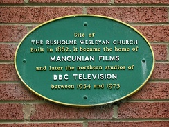 A plaque on a house wall marks the former site of Dickenson Road Studios