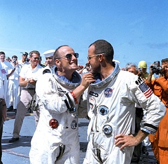 Pete Conrad (left) and Cooper on deck of recovery carrier USS Lake Champlain after Gemini 5 mission