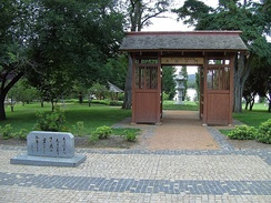 Canberra–Nara park with Kasuga stone lanterns framed by the gate