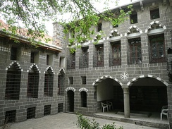 A typical example of Diyarbakır's historic architectural style, with masonry tiles built of the city's indigenous type of dark basalt stone.