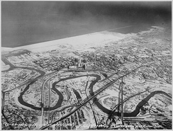 The Cuyahoga River winds through the Flats in a December 1937 aerial view of downtown Cleveland.