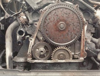 Valve timing gears on a Ford Taunus V4 engine — the small gear is on the crankshaft, the larger gear is on the camshaft. The crankshaft gear has 34 teeth, the camshaft gear has 68 teeth and runs at half the crankshaft RPM.(The small gear in the lower left is on the balance shaft.)
