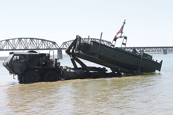 U.S. Army soldiers unload a Mk2 Bridge Erection Boat from a M1977A2 CBT HEMTT into the Missouri River