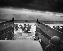 Into the Jaws of Death: Troops from the U.S. 1st Division landing on Omaha beach as part of Operation Overlord