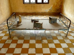 Iron bed in torture room at Tuol Sleng Genocide Museum