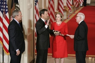 John Roberts is sworn in as Chief Justice by senior Associate Justice John Paul Stevens in the East Room of the White House on the same day as his confirmation, September 29, 2005.