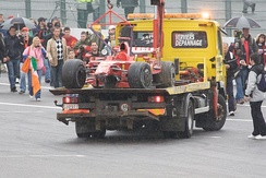Räikkönen's damaged Ferrari F2008 is brought back to the pits after the Finn crashed with two laps to go.