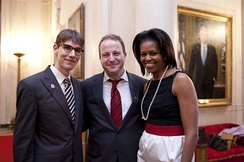 Polis (center) with his partner, Marlon Reis (left), and First Lady Michelle Obama at the White House