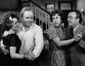 "Before becoming a regular cast member on All in the Family, Gardenia and Rue McClanahan played ""wife-swappers"" who meet the unsuspecting Bunkers in a 1972 episode. L-R: McClanahan, Carroll O'Connor, Jean Stapleton, and Gardenia.[10]"