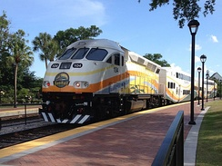 A southbound SunRail train leaving Winter Park Station