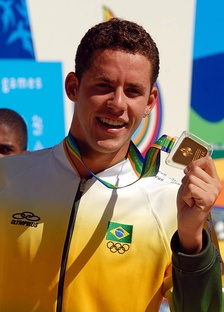 Swimmer Thiago Pereira of Brazil has a record 23 Pan American medals.[37] Here he holds a gold medal during the 2007 edition.