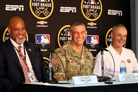 Tony Clark (left), Lt. Gen. Stephen J. Townsend (center), and Rob Manfred (right) at a pregame press conference