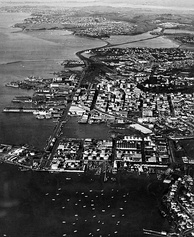 Looking east over the area that became Wynyard Quarter with the Auckland CBD in the middle distance, c. 1950s.