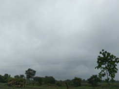 Low stratus fractus partly obscuring nimbostratus over Deccan Plateau, India