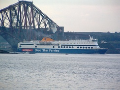 Blue Star 1 passing under the Forth Bridge in the Firth of Forth, en route from Rosyth to Zeebrugge.