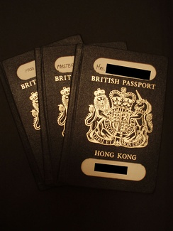 Three black Hong Kong BDTC passports, issued prior to its replacement by the  machine-readable passports in 1990.