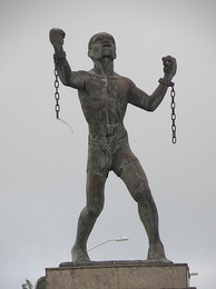 Statue of Bussa, who led the largest slave rebellion in Barbadian history.