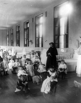 Sister Irene of New York Foundling Hospital with children. Sister Irene is among the pioneers of modern adoption, establishing a system to board out children rather than institutionalize them.