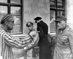 Prisoner of KZ Buchenwald with member of SS personnel after entry of U.S. Army 1945.