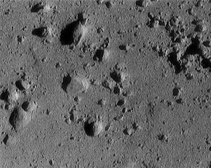 Taken from just 250 m above the surface of Eros as the NEAR Shoemaker spacecraft was landing, this image shows an area that is only 12 m across