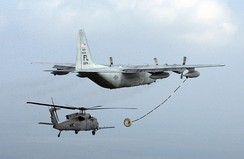 Probe-and-drogue – A USAF HC-130P refuels a HH-60 Pave Hawk.