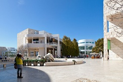 Architect Richard Meier chose beige-colored Italian travertine panels to cover the retaining walls and to serve as paving stones for the arrival plaza and Museum courtyard.[9]